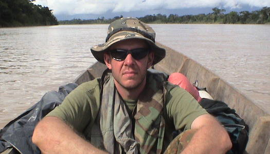 Dave dressed in camouflage sitting in a canoe